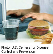 CDC graphic - kid on computer with soda and burger